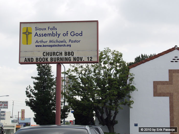 book burning church sign